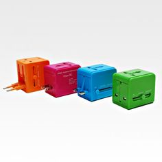 Universal Travel Adapter from Module R: This vibrantly colored adapter is easily stashed in a carry-on and designed for use in over 150 countries!