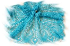 SIGH. Knit, not crochet but just gorgeous! This might make me want to learn to knit!  knitting peacock feathers shawl