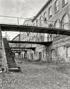 """I've walked this very spot many a time: ♥ Savannah, Georgia, circa 1937. """"Stoddard's Upper Range. Italianate structure built 1859 by John Stoddard on bluffs above the river, used for cotton factor's offices and warehouses."""" Photo by Frances Benjamin Johnston."""