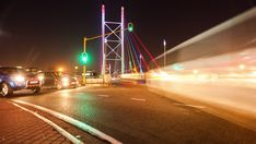 A colourful display of nighttime traffic crossing the Nelson Mandela Bridge in the city centre of Johannesburg. City Scene, Nelson Mandela, Travel And Tourism, Hd Video, Golden Gate Bridge, Night Time, Stock Footage, South Africa, Centre