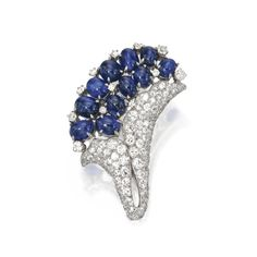 PLATINUM, SAPPHIRE AND DIAMOND CLIP-BROOCH, PAUL FLATO, CIRCA 1935 Of floral design set with round and single-cut diamonds weighing approximately 7.00 carats, and oval cabochon sapphires, signed Flato.