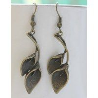 Beautiful pair of anthuriums in antique brass hanging from a earwire.Truly glamorous!.......Goes perfectly with daily wear,western wear,must for the modern woman at an stunning price of $6.