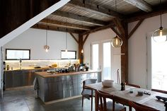 *Lights and open feel industrial touches Bovina House - rustic - kitchen - new york - kimberly peck architect  (Dining pendant lighting, concrete floors (heated my preference) & wood beams)