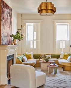 The sofa in this living design offers seating for the whole family. Paint Colors For Living Room, Rugs In Living Room, Home And Living, Living Room Decor, Rug Over Carpet, Live In Style, Rug Ideas, Hotel Interiors, Decorating Coffee Tables