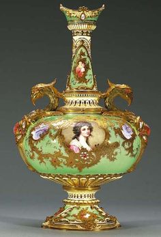A COALPORT 'JEWELLED' GREEN-GROUND GRYPHON-HANDLED BOTTLE VASE CIRCA 1895, GREEN PRINTED CROWNED MARK, PATTERN NO. V4065, BANNER MARK FOR TIFFANY & CO., NEW YORK, SIGNED F.(REDERICK) N. SUTTON