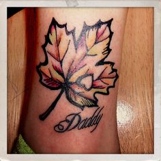Autumn leaf tattoo by TattooTarot. Love the heart cut out on this one.