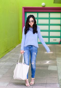 soft blue sweater, distressed jeans, nude wedges, statement sunglasses