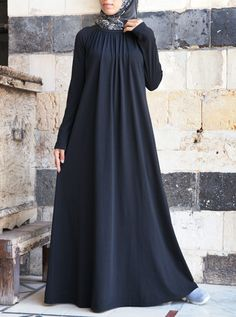 Soft gathering on this abaya begins at the neckline and cascades into a subtle flare, making this an utterly flattering style on any body type. The loose fit, raglan sleeves, and comfy jersey knit combine to create the ultimate casual abaya.