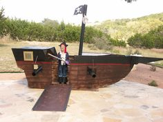 kid's dad made the pirate ship out of cardboard (made the pinata too... sheets from goodwill for sales)