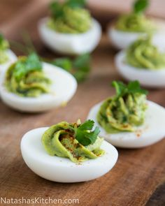 Avocado in eggs tastes surprisingly great and it's a healthier way to make these guacamole stuffed eggs! Everyone at your party will want to give 'em a try. Healthy Finger Foods, Healthy Snacks, Healthy Recipes, Healthy Appetizers, Yummy Recipes, Appetizers For Party, Appetizer Recipes, Egg Recipes, Cooking Recipes