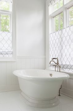 White Bathroom Flooring With Freestanding Bath Roman Shades