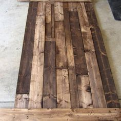 Step-by-step project guide on how to build a king-sized pallet headboard from scratch. This style headboard can be made for any size bed.