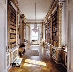 large long hallway library with a reading nook at the end by a window... perfection.