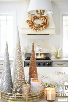 Elegant Christmas kitchen decorating with gold, silver and white. Glittery tress on a brass tray is the perfect touch on the kitchen island! Rose Gold Christmas Decorations, Elegant Christmas Decor, Cone Christmas Trees, Silver Christmas Tree, Classy Christmas, Christmas Aesthetic, Xmas Decorations, Cone Trees, Modern Christmas