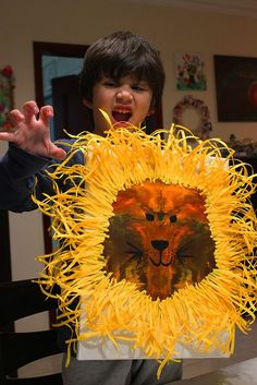 A fun and alluring art project for kids. So fascinating that when you open your paper to reveal the lion face, you think it's a painting that took days and hours to accomplish while it'…