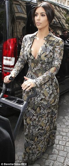 Kim Kardashian looked shapely in the fitted Valentino dress that she wore to her pre-wedding brunch, hosted by the designer