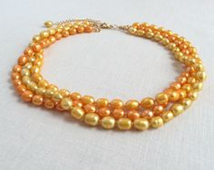 Yellow multistrand freshwater pearl necklace, by JJewelryDesign on Etsy https://www.etsy.com/listing/223552389/yellow-multistrand-pearl-necklace