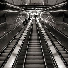 DESCENT 2, 2015 Photographer: Ken M Not only is there movement of the escalator, the height of it along with the dramatic use of one point perspective draws the viewer upwards.