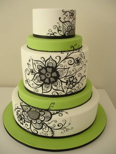 Love this wedding cake, flower & scroll design, with green layers for color. Stunning.