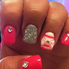 Pink, white, silver glitter, bow, stripes and rhinestones.
