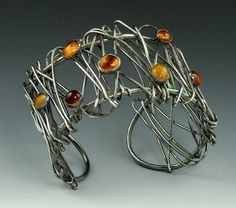 Cuff |  Michele Grady.  Sterling Silver and amber.