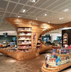 designed by Graft, a creative wooden installation for the Heinemann Duty Free shops in the Frankfurt Airport in Germany