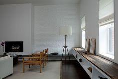 Contrast of white walls and dark materials - schist, wood counters, dark wood floor - clean