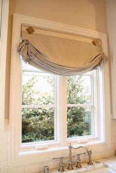 "Roman shade made from Robert Allen Serene Linen fabric with a 2"" pleated border from Samuel & Sons. This combination of Sterling and Oyster colors fits right in with current kitchen design trends"