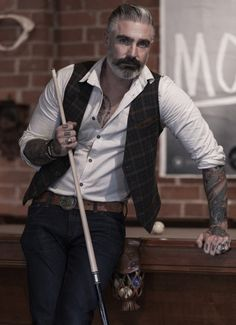 100 cotton yarn dyed twill lambskin leather details and back buckleback waistcoat Made in USA Extended sizes available for special order Contact info for more inf. Sharp Dressed Man, Well Dressed, Look Fashion, Mens Fashion, Style Masculin, Herren Style, Look Man, Mature Men, Hair And Beard Styles