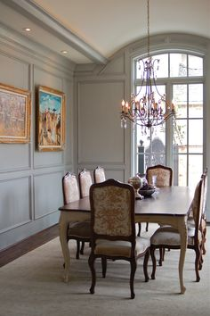formal dining room.  i love the panels on the wals, the arched ceiling, and the pretty window.