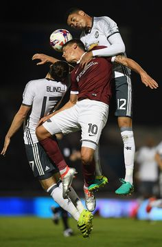 Alex Revell of Northampton Town is beaten to a header by Chris Smalling of…