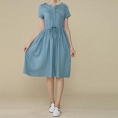linen dress--- in my dreams I wear this dress in France out in the country and I ride a bicycle with a basket and pick lavender