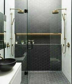 Double brass shower heads| Black matte hexagon floor to ceiling | Soap dish lighting | Glass shower enclosure