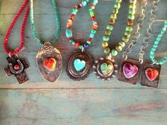 Heart J Cowgirl/Different shapes and colors of hearts and a coral/sterling Cross with horseshoe.