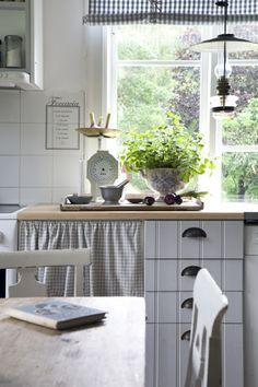 Soft pale gray & white check kitchen cabinet curtain.