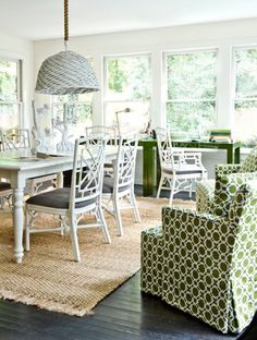 Melanie Turner Interiors - dining rooms - green, geometric, pattern, upholstered, armchairs, white, faux bamboo, dining chairs, charcoal, gray, cushions, fringe, jute, rig, white, turned leg, dining table, white, painted, woven, pendant, white dining table, white farmhouse dining table, white dining chairs, green parsons desk,
