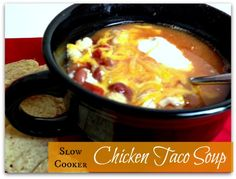 EASY slow cooker taco soup with chicken!    4 frozen chicken breast   2 cans or rotel tomatoes   2 cans of hominy or corn   2 cans of pinto beans or 3 cups of beans   1 Taco Seasoning packet   1 Ranch Dressing dry packet (I use fiesta)   4 cans of water   shredded cheese   tortilla chips   sour cream (optional)