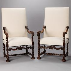 """Pair 19th Century French High Back Arm Chairs  --  Circa 1860s pair of large French armchairs with high backs, scrolled arms and decorative turned legs. Arms are 26.5-30"""" tall, seats are 18"""" high and 18"""" deep. Chairs are newly upholstered with muslin and ready for the fabric of your choice. Sold and priced as a pair.  --   Item:  6366 -- Retail Price:   $4195"""