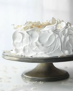 Raspberry White Cake  This cake is made with cream for a luxuriously rich texture. Cut through the fluffy meringue frosting to reveal the raspberry-flecked cake layers with raspberry jam in between