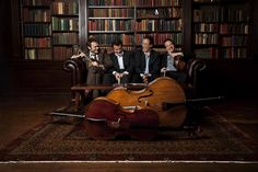 Yo Yo Ma and Company... A library and instruments; A lovely combination.