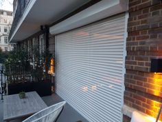 Providers of high quality concertina security grilles for windows & doors to effectively defend your homes and businesses against intruders in the United Kingdom. Rolling Shutter, Security Products, Roller Shutters, Gloucester, Facade House, Hyde Park, Gates, Blinds, Backyard