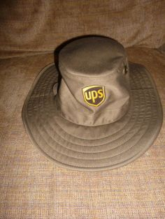 dab0dec97b0 OFFICIAL UPS BROWN WIDE BRIM HAT TWIN HILL UNITED PARCEL SERVICE More