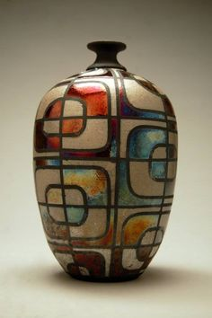 Ryan Peters. Bottle. Colorful design painted on bottle with ceramic stains before firing.