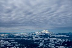 [OC] My dad took this picture from a plane. Sunrise over Mt. Rainier [21001400] #reddit