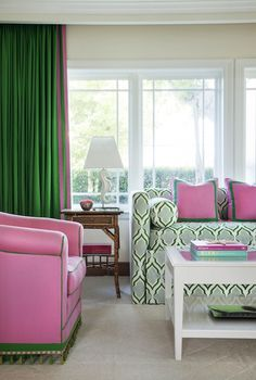 Pink and Green living room with green and blue patterned daybed accented with matching bolster ...