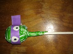 Use a green tootsie roll pop and wrap a bandanna made of construction paper around it for a ninja turtle sucker! Great party favor!