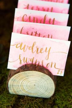 Watercolor pink and gold wedding place cards