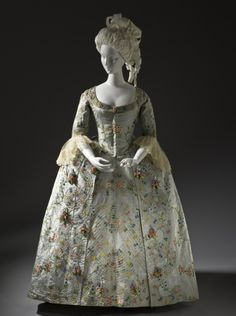Woman's Robe a la Française  Probably The Netherlands, circa 1775  Costumes; principal attire (entire body)  Silk plain weave (faille) with supplementary weft-float patterning, moiré finish, and silk passementerie with silk fly fringe