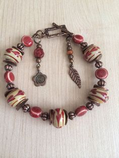 Boho bracelet, Lampwork beads with copper and earth tone clay beads for accents