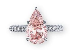 A COLOURED DIAMOND AND DIAMOND RING Set with a pear-shaped fancy intense orangy pink diamond weighing 2.21 carats, to the pavé-set diamond half-hoop, mounted in platinum